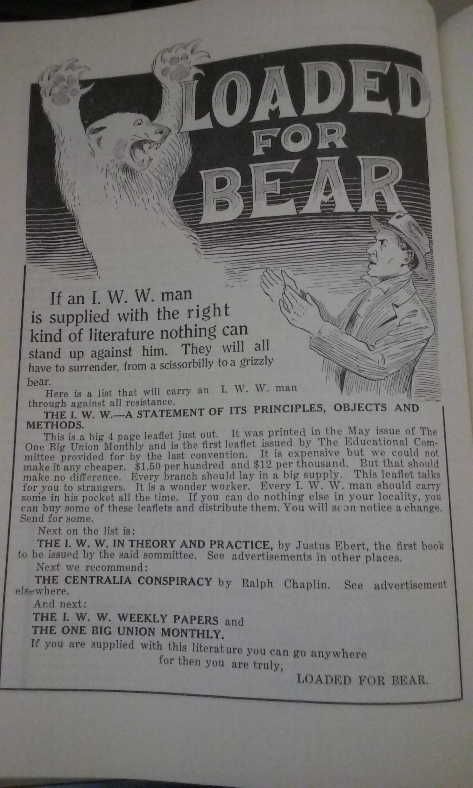 "Advert with a title that reads ""Loaded for Bear"" and suggests that an IWW member with the right kind of literature can stand against anyone - even a bear."